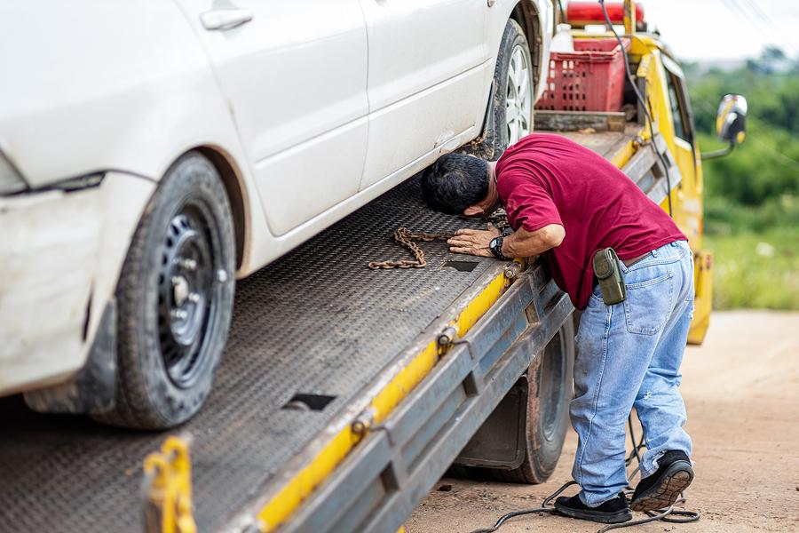 man inspecting the car